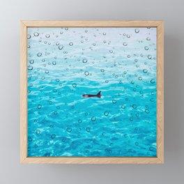 Orca Whale gliding through the water on a rainy day Framed Mini Art Print