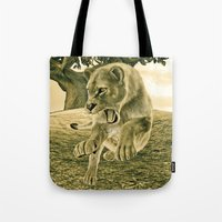 hunting Tote Bags featuring Hunting Lioness  by Design Windmill