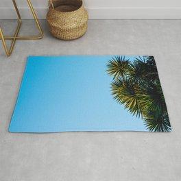 Minimalist Art Palm Tree Against Blue Sky Rug