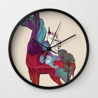 the last unicorn Wall Clocks featuring The Last Unicorn by nellfoxface