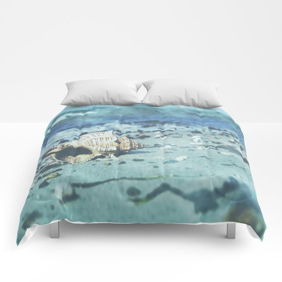 Shell on the beach Comforters