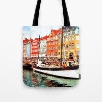 denmark Tote Bags featuring Copenhagen, Denmark by Philippe Gerber