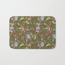 Garden tool with leaves and clover on brown background Bath Mat