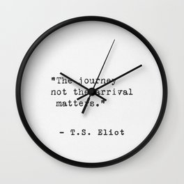 Eliot travel quote Wall Clock
