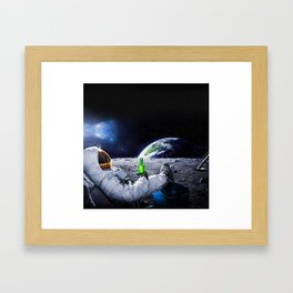 Funny Astronaut with space beer Framed Art Print
