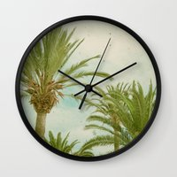palm trees Wall Clocks featuring Palm Trees by Cassia Beck