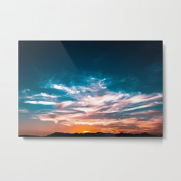 Light from the setting sun illuminating the sky and clouds Metal Print