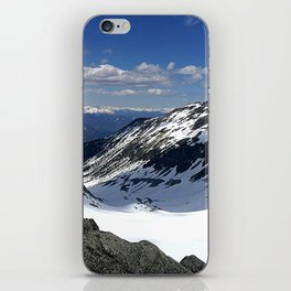 Mountains dappled with snow and rock iPhone Skin