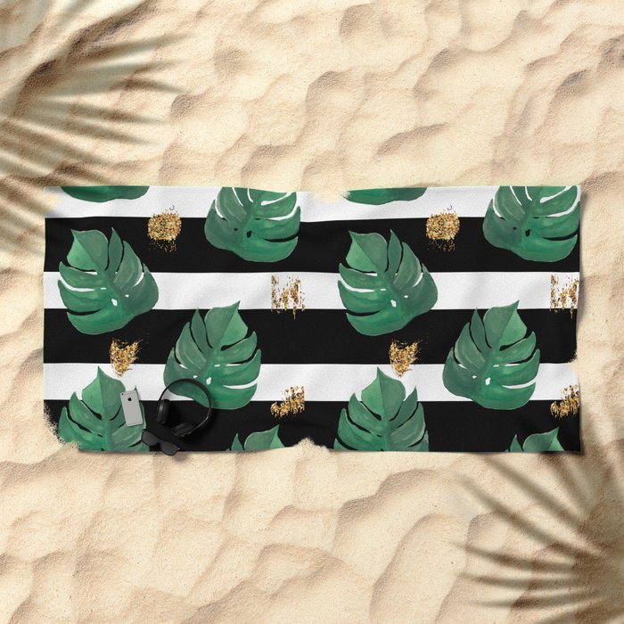 Tropical leaves pattern on stripes background Beach Towel