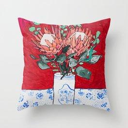 Delft Bird Vase of Proteas on Red Throw Pillow