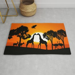 Giraffe silhouettes at sunset Rug