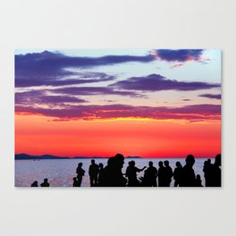 Silhouettes in the sunset Canvas Print