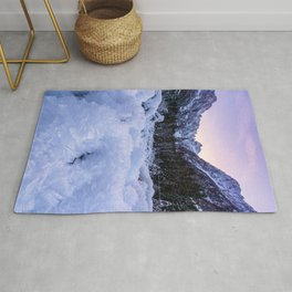 Frozen foliage and mountains at sunset Rug