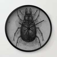 beetle Wall Clocks featuring Beetle by Salih Gonenli