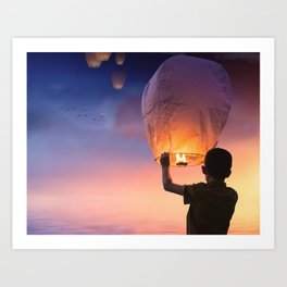 Boy Releasing Chinese Lanterns to the Sky Art Print