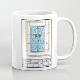 Blue Door with Black Decorations Coffee Mug
