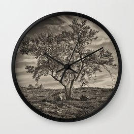 A tree in the mountains Wall Clock