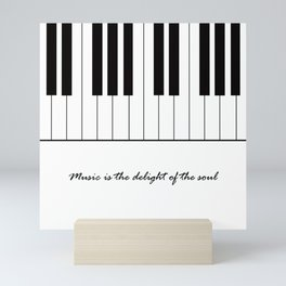 Music is the delight of the soul Mini Art Print