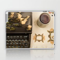 Little roses over an old typewriter and tea (Retro and Vintage Still Life Photography) Laptop & iPad Skin