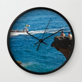 People on an islet Wall Clock