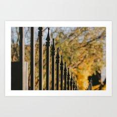 iron fence, yellow leaves Art Print