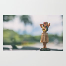 Hawaii road trip hula doll on car dashboard Rug