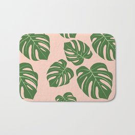 Monstera with pink background Bath Mat
