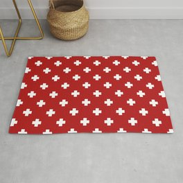 White Swiss Cross Pattern on Red background Rug