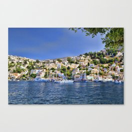 Symi island in Greece. Traditional houses. Sunny day with blue sky and sea. Canvas Print