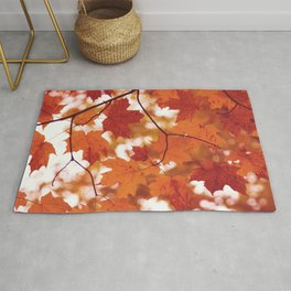 Fluttering from the Autumn tree Rug