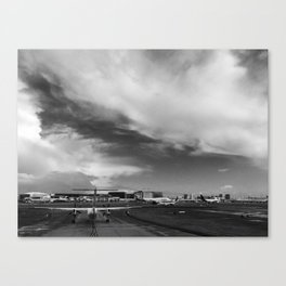 Airliner taxiing on a runway Canvas Print