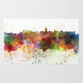 Lansing skyline in watercolor background Rug
