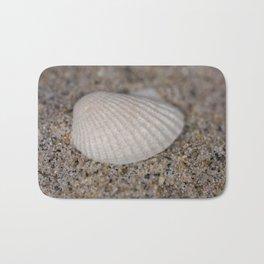 Sea shell on the beach Bath Mat