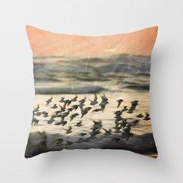 Flock over ocean Throw Pillow