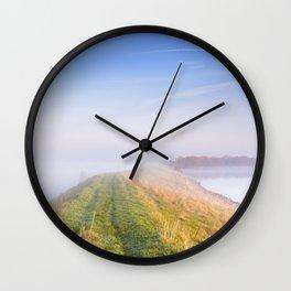 Typical Dutch landscape in Zeeland on a foggy morning Wall Clock