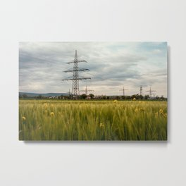 Landscape view of the electric tower over the rapeseed plantation in Germany Metal Print