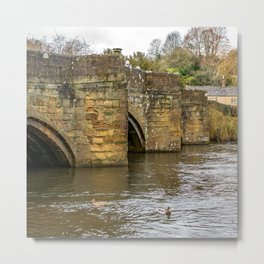 Ancient stone bridge crossing the River Wye in the town of Bakewell Metal Print