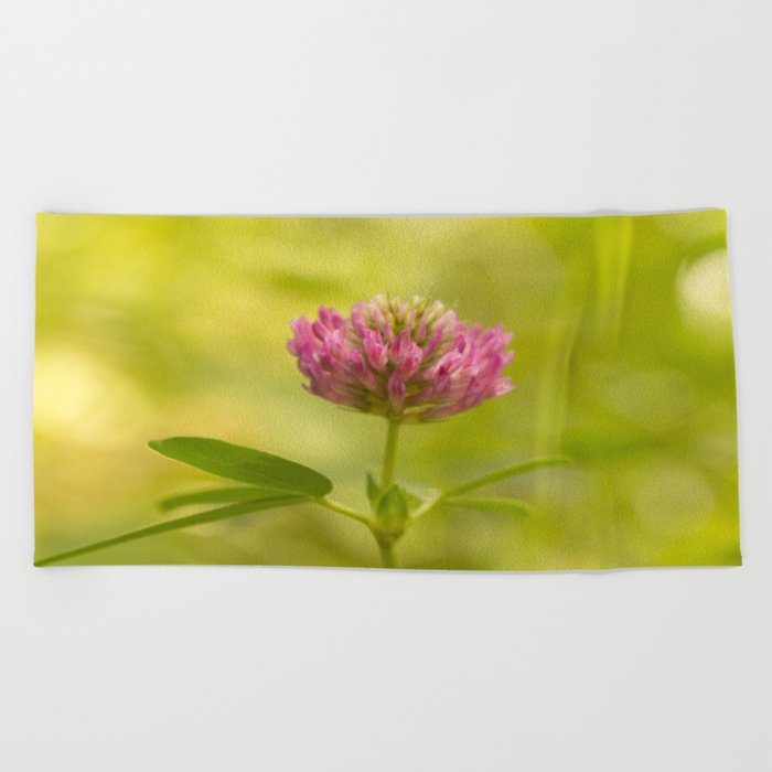 Red clover on green blur nature background #decor #society6 Beach Towel