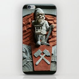 Gnome figure on building iPhone Skin
