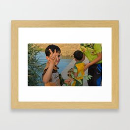 Victory sign from iraqi kid Framed Art Print