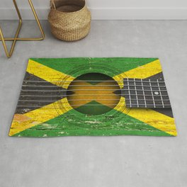 Old Vintage Acoustic Guitar with Jamaican Flag Rug