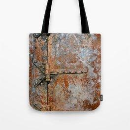 Rusty metal door details Tote Bag