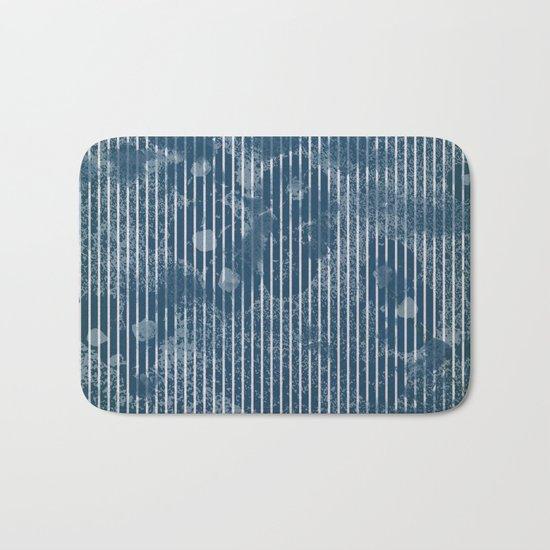 White stripes on grunge textured blue background Bath Mat