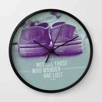 not all who wander are lost Wall Clocks featuring Not all those who wander are lost by Gal Ashkenazi