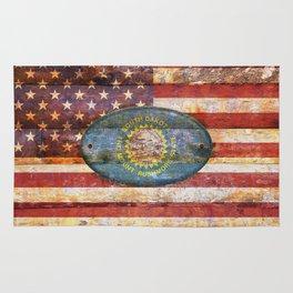 South Dakota flag on brown wooden planks. Rug