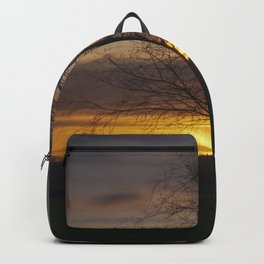 Sunset at the end of town Backpack