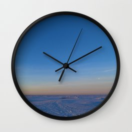 Dawn in the blue cloudless sky over the white snow ice desert of the frozen sea Wall Clock