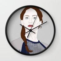 katniss Wall Clocks featuring Katniss Everdeen by raeuberstochter