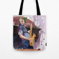 saxophone Tote Bags featuring Playing saxophone by aurora villaviejas
