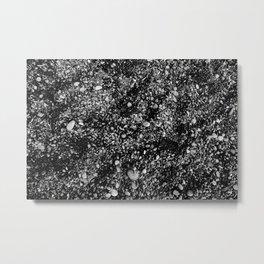 Stones in black sand beach Metal Print